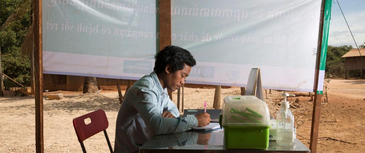 Mmw sits at his mobile malaria post in lom kob village (luke duggleby)