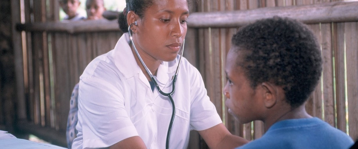 Nursing officer Janet Peters checking 8 year old Lantion Puime Health Clinic Siremi Community School Oro Province, Papua New Guniea © Don Brice ABM 2003